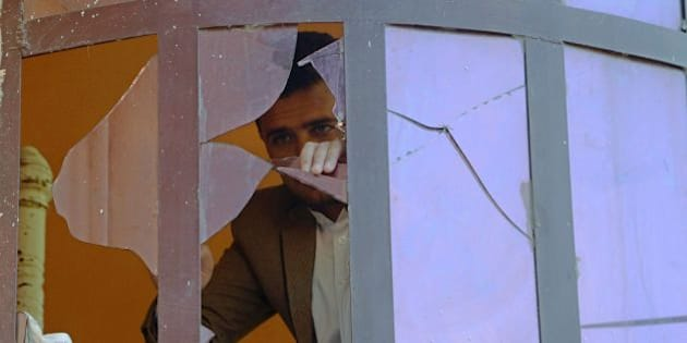 An Afghan man is seen through the shards of a broken window after a blast near the Indian consulate in Jalalabad on January 5, 2016.  A small bomb exploded near the Indian consulate in the eastern Afghan city of Jalalabad on January 5, authorities said, after a series of attacks on Indian installations in the region. The blast was some 200 metres from the consulate in Jalalabad, an Indian diplomatic source there told AFP. There were no reported injuries at the scene.  AFP PHOTO / Noorullah Shirzada / AFP / Noorullah Shirzada        (Photo credit should read NOORULLAH SHIRZADA/AFP/Getty Images)