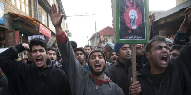 Kashmiri Shiite Muslims, carrying a placard with the portrait of Sheikh Nimr al-Nimr, shout slogans during a protest in Srinagar, Indian controlled Kashmir, Saturday, Jan. 2, 2016. Hundreds of Shiite Muslims in Indian portion of Kashmiri rallied in the Shia dominated areas protesting against Saudi Arabia , after they announced on Saturday it had executed 47 prisoners convicted of terrorism charges, including al-Qaida detainees and a prominent Shiite cleric who rallied protests against the government. (AP Photo/Dar Yasin)