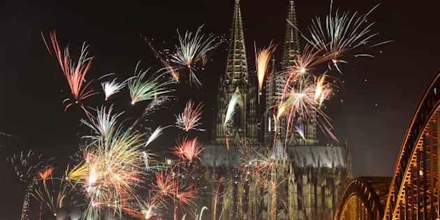 Fireworks light up the Dom church on the Rhine river in Cologne, western Germany after midnight on January 1, 2013, as part of the New Year celebrations.  