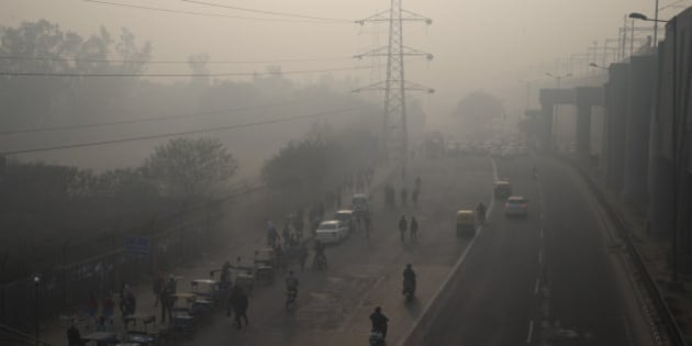 Vehicles ply on a smog enveloped morning during a two-week experiment to reduce the number of cars to fight pollution in New Delhi, India, Monday, Jan. 4, 2016. To reduce pollution in one of the most polluted cities in the world, the Delhi government has allowed private cars on the roads on alternate days from Jan. 1-15, depending on whether their license plates end in an even or an odd number. (AP Photo/Tsering Topgyal)