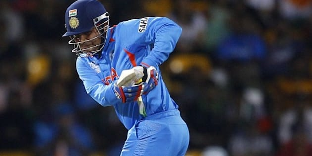 India's batsman Virender Sehwag plays a shot during the ICC Twenty20 Cricket World Cup Super Eight match against South Africa in Colombo, Sri Lanka, Tuesday, Oct. 2, 2012. (AP Photo/Aijaz Rahi)