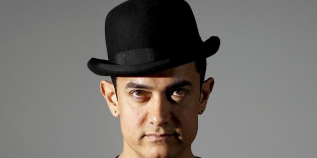 Bollywood actor Aamir Khan attends a trailer launch of his film Dhoom 3 in Mumbai, India, Wednesday, Oct. 30, 2013. Dhoom 3 is a Hindu action thriller film that will be released on Dec. 20. (AP Photo/Rajanish Kakade)