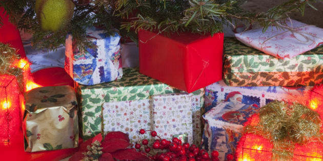 Festivals, Religious, Christmas, Detail of lights and decorations and xmas gifts under a Nordman Fir tree.