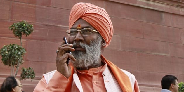NEW DELHI, INDIA - DECEMBER 1: BJP MP Sakshi Maharaj during the winter session of Parliament on December 1, 2015 in New Delhi, India. Today's Parliament adjourned over the debate on intolerance in the Lok Sabha. In the Lok Sabha, Rahul Gandhi tore into the government as he listed examples of alleged intolerance. (Photo by Sanjeev Verma/Hindustan Times via Getty Images)