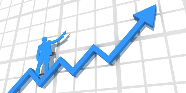 A 3d rendered blue arrow trending upwards on a blank line chart with a silhouetted blue businessman standing and pointing on it.