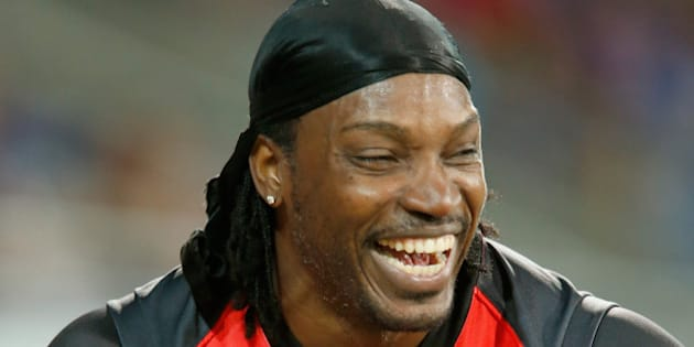 HOBART, AUSTRALIA - JANUARY 04:  Chris Gayle of the Melbourne Renegades laughs after giving a TV interview to Mel Mclaughlin during the Big Bash League match between the Hobart Hurricanes and the Melbourne Renegades at Blundstone Arena on January 4, 2016 in Hobart, Australia.  (Photo by Darrian Traynor/Getty Images)
