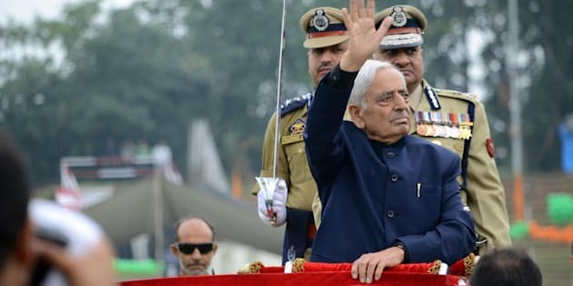 KASHMIR, INDIA - AUGUST 15: Kashmir's chief minister Mufti Mohammad Sayeed greets the people during the official celebrations for India's Independence Day at Bakshi Stadium in Srinagar, the summer capital of Indian administered Kashmir on 15 August 2015. A complete shutdown called by Kashmiri separatists leader and an appeal of black day is being observed across Kashmir on August 15, 2015. (Photo by Faisal Khan/Anadolu Agency/Getty Images)