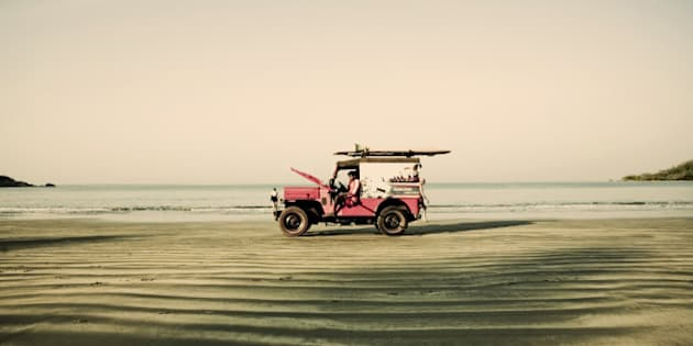 Red jeep on the beach