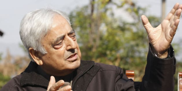 SRINAGAR, INDIA - OCTOBER 28: Peoples Democratic Party Chief Mufti Mohammad Sayeed addressing a press conference regarding ceasefire violations along the border by Pakistan at his residence on October 28, 2013 in Srinagar, India. PDP Chief said that issue has to be addressed politically and the two countries have to respect the yearning for peace in J&K. (Photo by Waseem Andrabi/Hindustan Times via Getty Images)