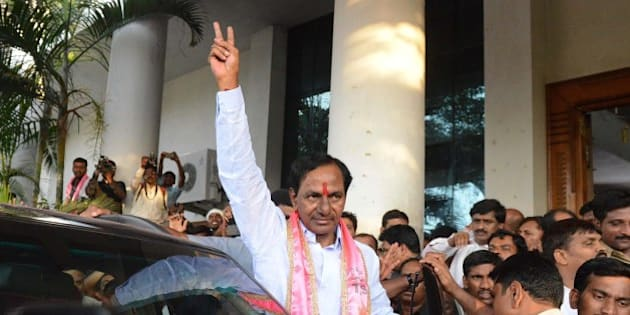 Indian Telangana Rashtra Samithi (TRS) party president K Chandrasekhar Rao (C) greets supporters at Telangana Bhavan in Hyderabad on May 16, 2014. Telangana Rashtra Samithi led by K Chandrasekhar Rao is set to form the first government in Telangana state with his party heading towards a majority in the Assembly polls. India's triumphant Hindu nationalists declared 'the start of a new era' in the world's biggest democracy after hardline BJP leader Narendra Modi propelled them to a stunning win on a platform of revitalizing the sickly economy .AFP PHOTO / Noah SEELAM        (Photo credit should read NOAH SEELAM/AFP/Getty Images)