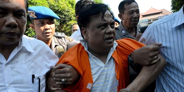 Indian national Rajendra Sadashiv Nikalje, 55, known in India as Chhota Rajan, is brought out from a holding cell at the Bali police headquarters in Denpasar on Bali island on November 2, 2015. An alleged Indian crime boss wanted in his home country for up to 20 murders has been arrested in Indonesia after two decades on the run, police said October 26. Nikalje had been evading police in several countries for years, with Interpol flagging him as a wanted man back in 1995. AFP PHOTO / SONNY TUMBELAKA        (Photo credit should read SONNY TUMBELAKA/AFP/Getty Images)