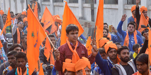 Indian activists of Hindu Bajrang Dal, along with Vishva Hindu Parishad (VHP) organizations, raise religious slogans during a procession marking the 23rd anniversary of the demolition of the Babri Masjid Mosque in Ayodhya, in Amritsar on December 6, 2015.  Hindu hardliners demolished the Babri Mosque on December 6, 1992, claiming it was built on the site of the birth place of the Hindu God Ram, sparking off country wide Hindu-Muslim riots.   AFP PHOTO / NARINDER NANU / AFP / NARINDER NANU        (Photo credit should read NARINDER NANU/AFP/Getty Images)
