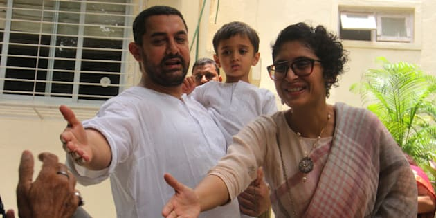 MUMBAI, INDIA - JULY 18: Bollywood actor Aamir Khan with wife Kiran Rao and son Azaad greets fans at Carter Road residence on the occasion of EID on July 18, 2015 in Mumbai, India. (Photo by Pramod Thakur/Hindustan Times via Getty Images)