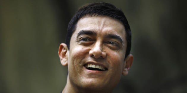 """Bollywood actor Aamir Khan smiles as he takes questions from a journalist during a press conference to promote his new film """"Talaash,"""" or Search, at his residence in Mumbai, India, Tuesday, Dec. 4, 2012. (AP Photo/Rafiq Maqbool)"""