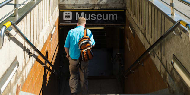 TORONTO, ONTARIO, CANADA - 2015/06/03: Toronto everyday scenes: Man walking down the stairs of the underpass leading to the Museum subway station. Museum is a subway station on the Yonge University line in Toronto. It is located under Queen's Park beside the Royal Ontario Museum. (Photo by Roberto Machado Noa/LightRocket via Getty Images)