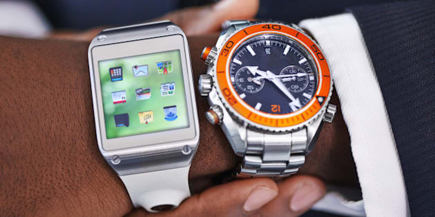 Cropped view of a young businessman wearing a smartwatch and a traditional watch - All screen content is designed by us and not copyrighted by othershttp://195.154.178.81/DATA/i_collage/pi/shoots/783764.jpg