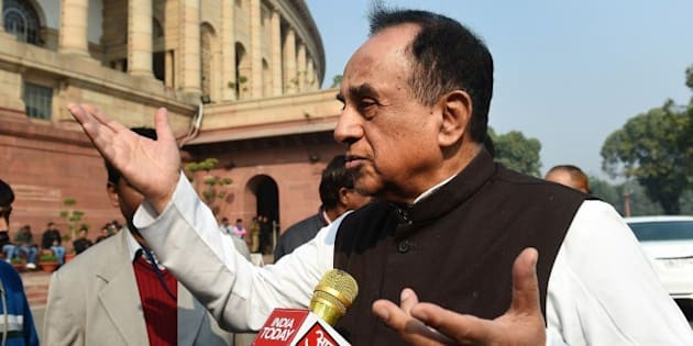 Bhartiya Janata Party (BJP) leader Subramaniam Swamy interacts with members of the media at Parliament House in New Delhi on December 17, 2015.   Indian Congress Party president Sonia Gandhi and vice president Rahul Gandhi are due to appear in a Delhi court on December 19, 2015 in the National Herald case, filed by Indian politician Subramanian Swamy.     AFP PHOTO / PRAKASH SINGH / AFP / PRAKASH SINGH        (Photo credit should read PRAKASH SINGH/AFP/Getty Images)