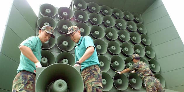 PAJU, REPUBLIC OF KOREA:  South Korean soldier tear down a battery of propaganda loudspeakers along the border with North Korea in Paju on 16 June 2004. The dismantlement followed an inter-Korean to remove all propaganda materials along the world's last Cold War frontier.AFP PHOTO/ KIM JAE-HWAN  (Photo credit should read KIM JAE-HWAN/AFP/Getty Images)