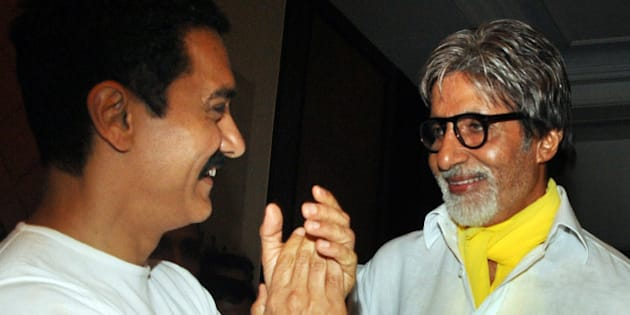 Indian Bollywood film actors Amitabh Bachchan (R) and Aamir Khan attend the tenth anniversary celebration party of Hindi film 'Lagaan' in Mumbai on June 15, 2011.  PHOTO/STR (Photo credit should read STR/AFP/Getty Images)