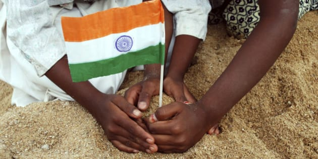 children giving support to the Indian flag....
