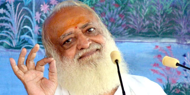 This photograph taken on August 11, 2013, shows self-styled Indian 'godman' Asaram Bapu as he gestures during a ceremony in Jodhpur. The popular Indian guru remained defiant over allegations that he sexually assaulted a schoolgirl, angrily saying he was 'ready to go to prison' over the affair.  AFP PHOTO/STR        (Photo credit should read STRDEL/AFP/Getty Images)