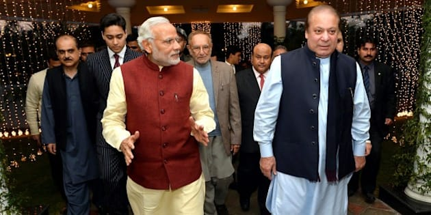 LAHORE, PAKISTAN - DECEMBER 25: Prime Minister of Pakistan Nawaz Sharif (R) welcomes Indian Prime Minister Narendra Modi (L) at Allama Iqbal International Airport in Lahore, Pakistan on December 25, 2015. (Photo by Indian Press Information office/Anadolu Agency/Getty Images)