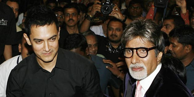 Indian bollywood actor Aamir Khan (L) is pictured with Indian Bollywood actor Amitabh Bachchan at the book launch of 'Bachchanalia,' the films and memorabilia of Amitabh Bachchan, in Mumbai on January 3, 2009. AFP PHOTO / Sajjad HUSSAIN (Photo credit should read SAJJAD HUSSAIN/AFP/Getty Images)