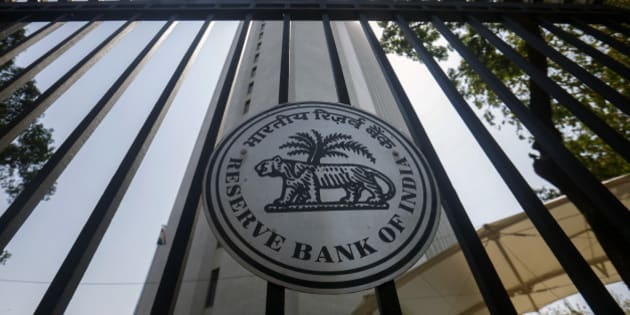 The Reserve Bank of India (RBI) logo is displayed on a gate at the central bank's headquarters in Mumbai, India, on Tuesday, April 1, 2014. Indias central bank left its key interest rate unchanged as consumer-price inflation eased to a two-year low and the rupee strengthened, increasing scope to support growth ahead of national elections starting this month. Photographer: Vivek Prakash/Bloomberg via Getty Images