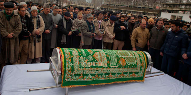 SRINAGAR, KASHMIR, INDIA - JANUARY 07: Pro Indian politician and supporters carry the casket bearing the body of pro Indian Jammu and Kashmir Chief Minister Mufti Mohammad Sayeed  during his funeral, on January 07, 2016 in Srinagar, the summer capital of Indian-controlled  Kashmir, India. Mufti Mohammad Sayeed, a pro Indian politician of Indian administered Kashmir, served twice as the Chief Minister of strife torn Jammu and Kashmir; for three years from November 2002 till November 2005 and then again from March 2015 until his death in January 2016. Mufti died on Thursday morning at the All India Institute of Medical Sciences in Delhi, where he remained admitted for 14 days. His daughter Mehbooba Mufti is set to take over as Chief Minister . Sayeed was also Home Minister of Indian  government from December 1989 to November 1990. He founded the Jammu and Kashmir People's Democratic Party, in July 1999. He died on 7 January 2016 at , Delhi due to multiple organ failure. (Photo by Yawar Nazir/Getty Images)