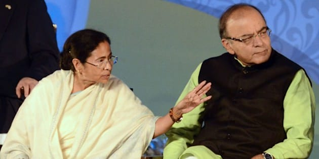 The Chief Minister of the Indian state of West Bengal Mamata Banerjee (L) gestures as Indian Union Finance Minister Arun Jaitley looks on during the start of the Bengal Global Business Summit 2016 in Kolkata on January 8, 2016. Business delegates from more than 25 countries are taking part in the two-day event. AFP PHOTO / DIBYANGSHU SARKAR / AFP / DIBYANGSHU SARKAR        (Photo credit should read DIBYANGSHU SARKAR/AFP/Getty Images)
