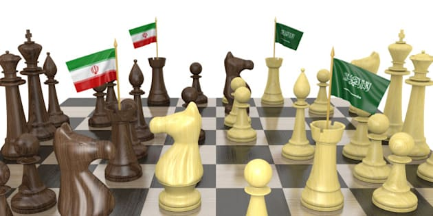 Foreign policy strategy concept of a chess board with rooks carrying national flags for Iran and Saudi Arabia.