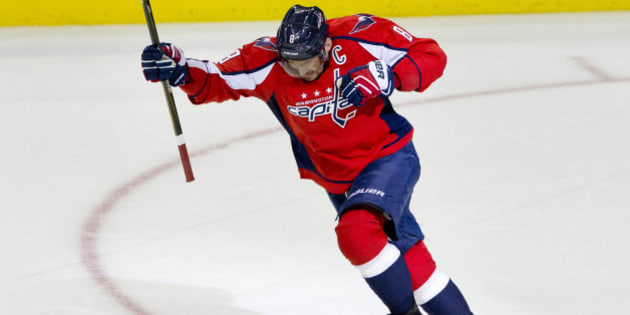 The Washington Capitals left wing Alex Ovechkin, (8), of Russia, leaps in the air in celebration after scoring his 500th career NHL goal during the second period of a hockey game against the Ottawa Senators in Washington, D.C., Sunday, Jan. 10, 2016. (AP Photo/Jacquelyn Martin)