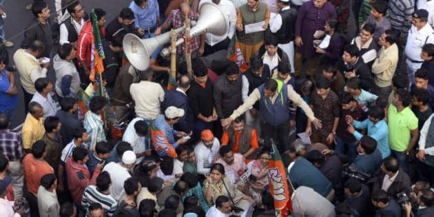 KOLKATA, WEST BENGAL, INDIA - 2016/01/06: BJP State Yuva Morcha organized a half hour roadblock at M.G. Road and C.R. Avenue crossing protesting against Kaliachowk, Malda incident. (Photo by Saikat Paul/Pacific Press/LightRocket via Getty Images)