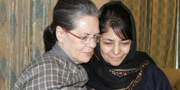 SRINAGAR, INDIA - JANUARY 10: Congress President Sonia Gandhi meets PDP President Mehbooba Mufti to offer condolences on the demise of her father Mufti Mohammad Sayeed on January 10, 2016 in Srinagar, India. Mufti died on Thursday at AIIMS in New Delhi. He had been undergoing treatment there since December 24. (Photo by Waseem Andrabi/Hindustan Times via Getty Images)