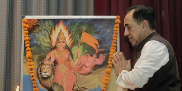 "Opposition Janata Party President Subramanian Swamy folds his hand in reverence after a traditional lamp lighting ritual before an illustration representing ""Mother India"" during an event against corruption in New Delhi, India, Saturday, Feb. 4, 2012. Judge O.P. Saini dismissed Swamy's petition plea for trial of Home Minister Palaniappan Chidambaram along with former telecommunications minister Andimuthu Raja who was forced to resign last year because of a multibillion-dollar telecoms scandal and later arrested by police. Two days ago, India's top court ruled that the 122 licenses granted in the 2008 deal be scrapped. (AP Photo/Gurinder Osan)"