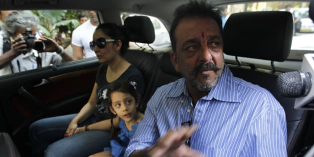 MUMBAI, INDIA - JANUARY 8: Bollywood actor Sanjay Dutt with wife Manyata and kids before leaving for Yerawada Jail to serve the remainder of his term after 14-day-long furlough ended on January 8, 2015 in Mumbai, India. Dutt was convicted for illegal possession and destruction of an AK-56 army assault rifle during the 1993 Mumbai communal conflagration before the March 12, 1993 serial bomb blasts in the city. (Photo by Vijayanand Gupta/Hindustan Times via Getty Images)