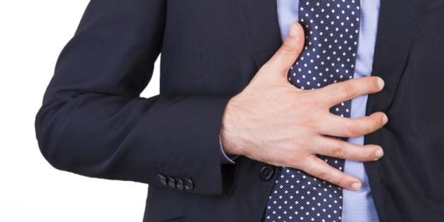 Businessman suffering from heartburn.
