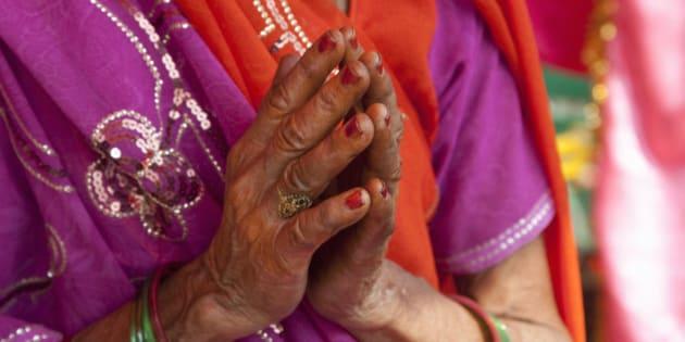 Woman praying at Hindu temple.