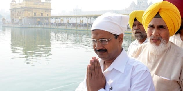 AMRITSAR, INDIA - OCTOBER 24: Delhi Chief Minister Arvind Kejriwal and AAP Punjab convener from Chhotepur, Sucha Singh paying obeisance at Golden Temple on October 24, 2015 in Amritsar, India. Kejriwal said that it was the responsibility of Punjab government to arrest the real culprits behind the incidents of desecration of holy books, adding no innocent person should be slapped with false cases. (Photo by Sameer Sehgal/Hindustan Times via Getty Images)