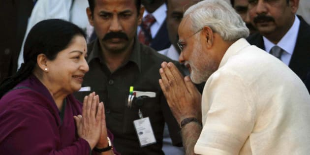 Tamil Nadu state Chief Minister J. Jayalalithaa, left, greets Bharatiya Janata Party (BJP) leader Narendra Modi before the oath taking ceremony, in Ahmadabad, India, Wednesday, Dec. 26, 2012. Hindu nationalist leader Narendra Modi won a resounding victory in state elections was sworn in Wednesday for a fourth term as chief minister in the western Indian state of Gujarat. (AP Photo/Ajit Solanki)
