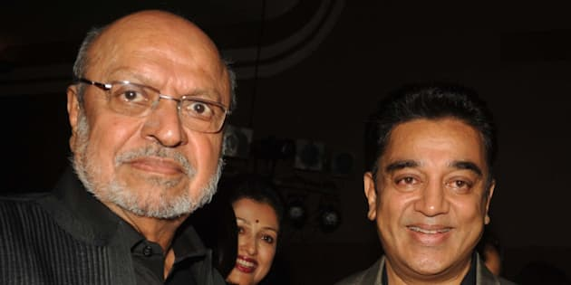 Indian Bollywood directors Shyam Benegal and actor Kamal Haasan attend the opening of the 15th Mumbai Film Festival (MAMI) in Mumbai on October 17, 2013. AFP PHOTO/STR        (Photo credit should read STRDEL/AFP/Getty Images)