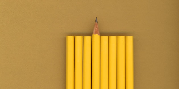 Sharpened pencil next to unsharpened pencils
