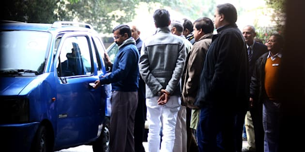 NEW DELHI, INDIA - DECEMBER 24: Delhi Chief Minister, Arvind Kejriwal, getting into his old Maruti wagon R, after meeting the LT governor in Delhi, on December 24, 2013 in New Delhi, India. Making  spectacular electoral debut, newly formed AAP emerged as the second-largest party in Delhi winning 28 of the 70 Assembly seats. (Photo by Ramesh Pathania/Mint via Getty Images)