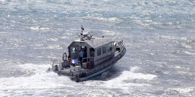 French maritime gendarmes in a boat take part in the search for wreckage from the missing MH370 plane off of Saint-Marie on the French island of La Reunion on August 14, 2015. France will conduct air and sea searches off its Indian Ocean territory of Reunion until the start of next week for debris from missing flight MH370, the island's top official said on August 12. AFP PHOTO / RICHARD BOUHET        (Photo credit should read RICHARD BOUHET/AFP/Getty Images)