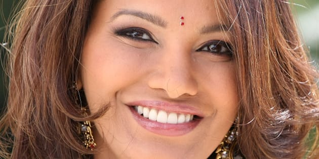"Former Miss World 1997, Diana Hayden of India poses for photographers during the MIPTV (International Television Programme Market), Tuesday, April 5, 2011, in Cannes, southern France. She presents the new reality format ""The Incredible Indian Bride"". (AP Photo/Lionel Cironneau)"