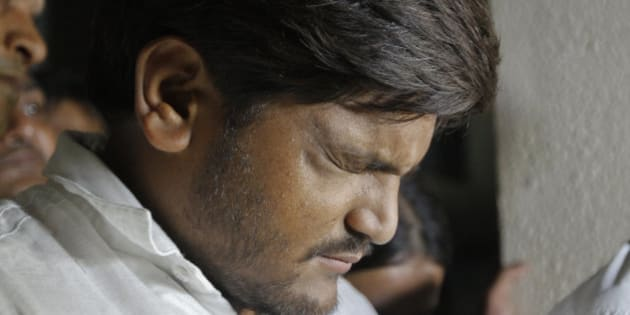 Hardik Patel, a popular leader of Patidars, a farming caste group, gestures as he speaks with media at his lawyer's office in Ahmadabad, India, Wednesday, Sept. 23, 2015.The Patidars, also known as the Patel community for the last name they share, are demanding the same special status given to many minorities in India, guaranteeing them a share of government jobs and school placements. (AP Photo/Ajit Solanki)