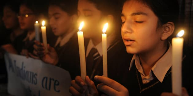 Indian school girls hold candles at DAV Public school in Amritsar on November 26, 2010 in tribute to those killed in the 26/11 Mumbai attacks. India marked today the second anniversary of the militant attacks on Mumbai with memorial events and prayer meetings to honour the 166 victims killed during 60 hours of carnage. AFP PHOTO/NARINDER NANU (Photo credit should read NARINDER NANU/AFP/Getty Images)