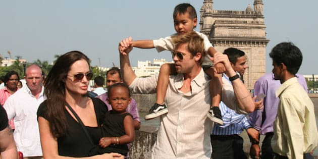 **FILE** Actress and UNHCR Ambassador Angelina Jolie, left, with daughter Zahara, and Brad Pitt, second right, with son Maddox, walk near the Gateway of India, in background, in Mumbai, India, in this Nov. 12, 2006 file photo. The megastars were spotted Friday, Aug. 24, 2007 with kids Maddox, Zahara and Pax shopping at Lee's Art Shop on West 57th Street. Baby Shiloh was not there. (AP Photo)
