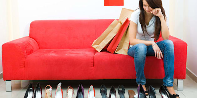 Woman looking at row of shoes