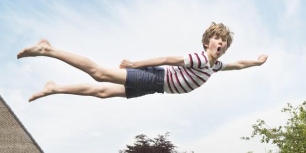 Kid flying through the air like superman